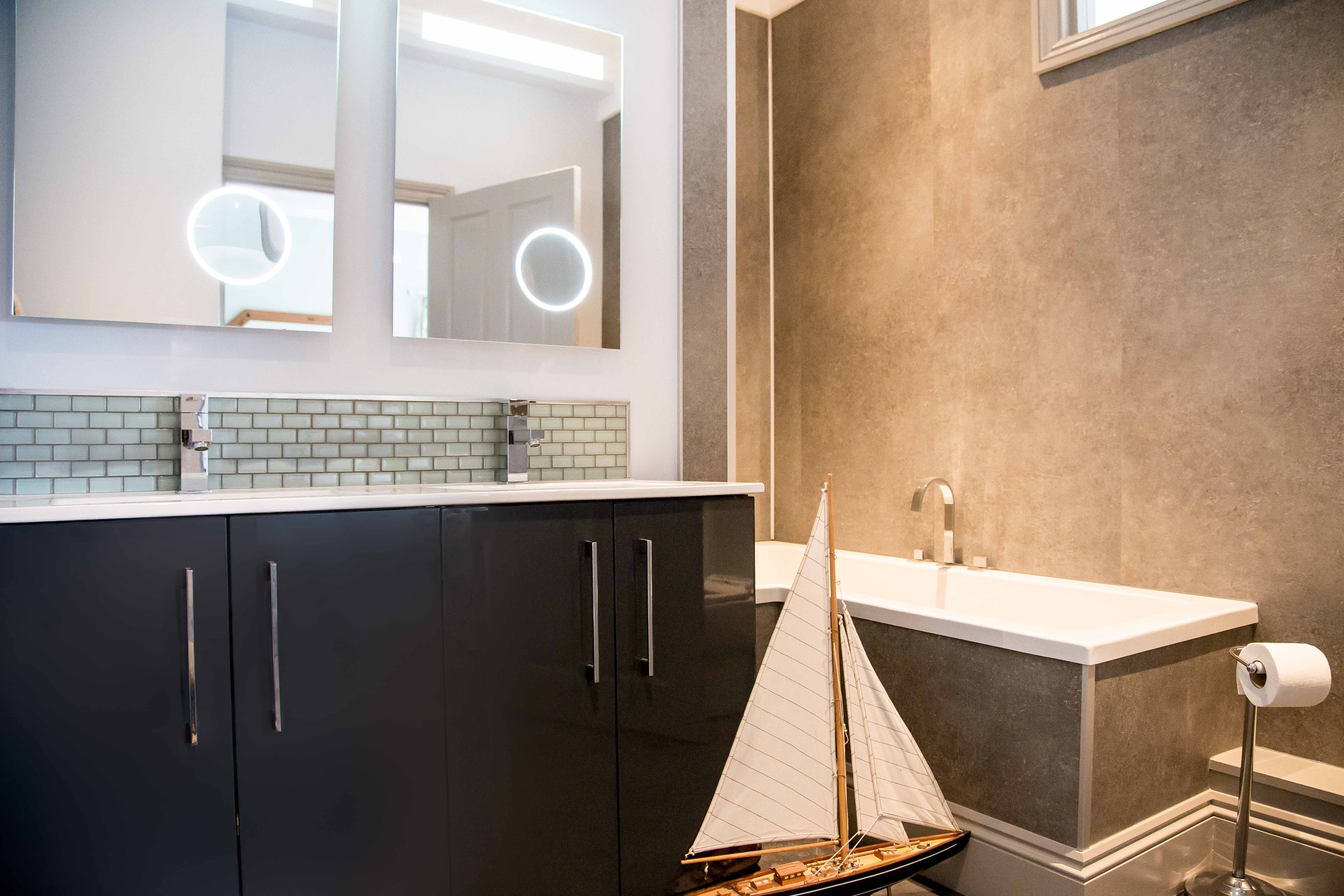 Sleek modern bathrooms with underfloor heating