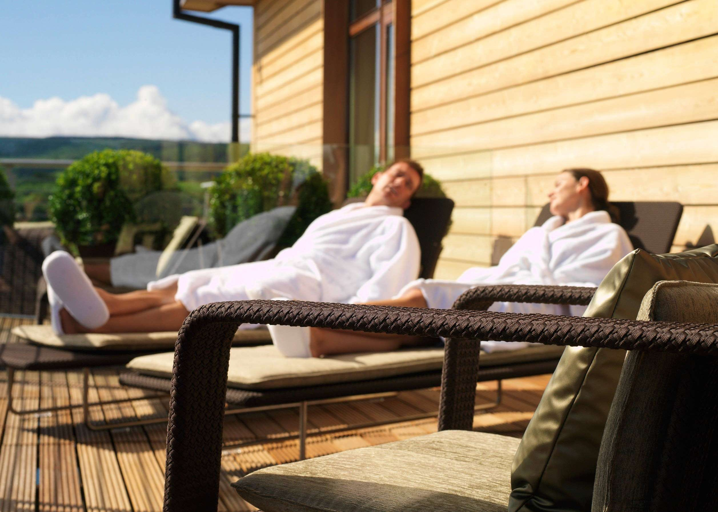 Couple relaxing Outside at Spa at Carrick Estate