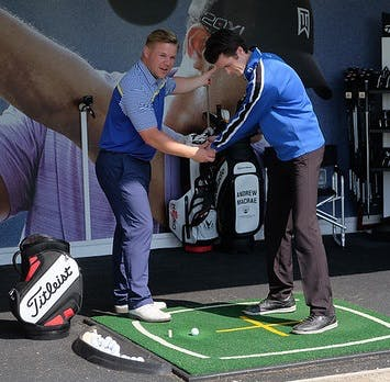 Golf coach giving golf lessons in Loch Lomond