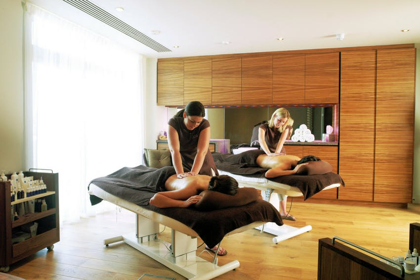 Guests receiving a massage at the Spa at Cameron House in Loch Lomond