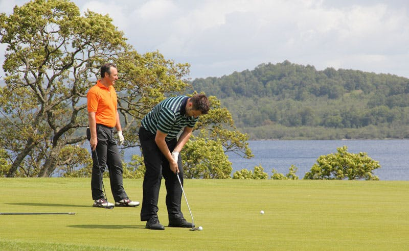 Golfers Putting at Loch Lomond