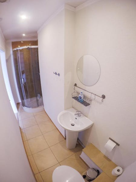 Ensuite bathroom with shower, sink and toilet. Towels and toiletries provided
