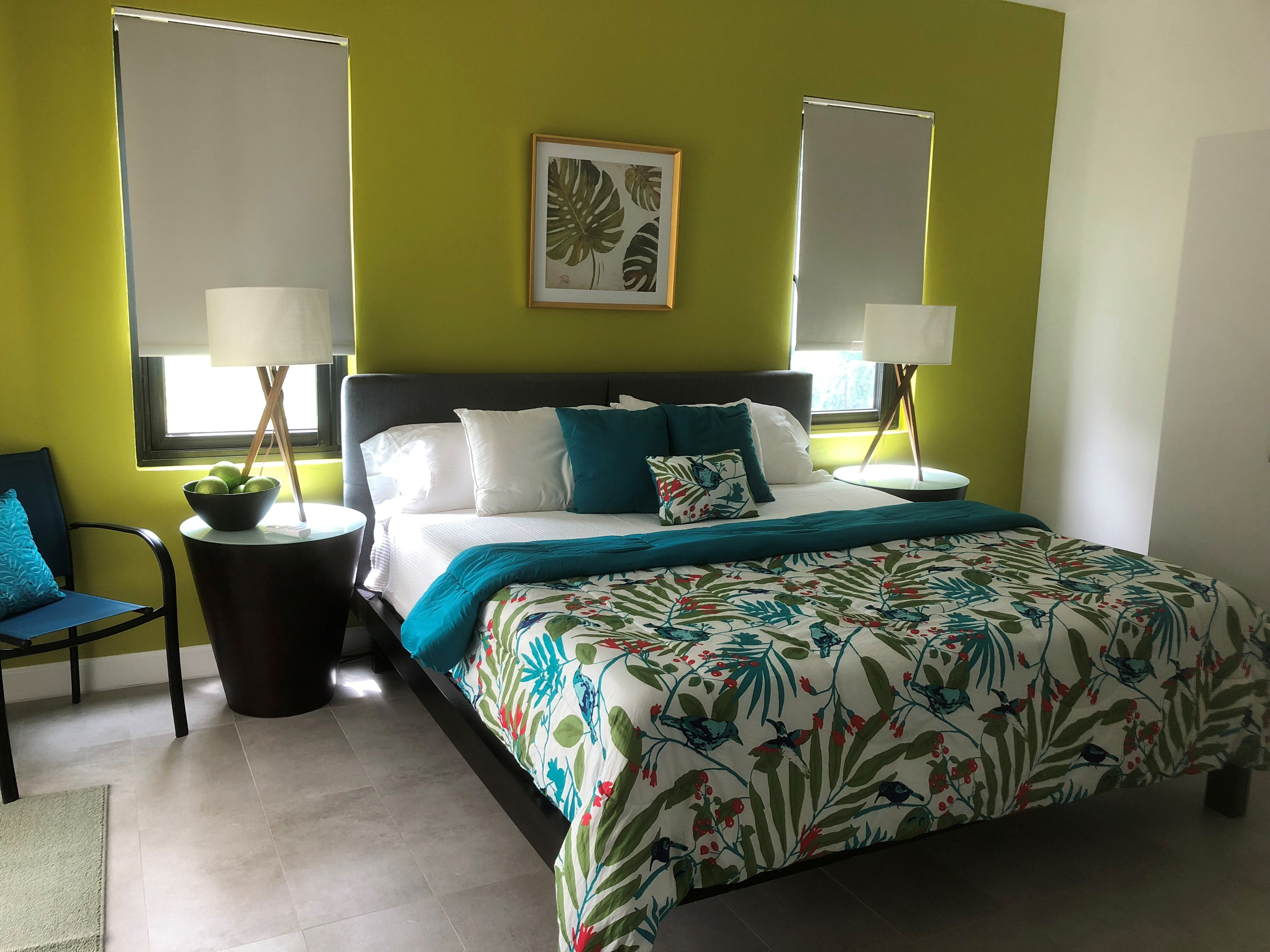 Emerald Garden King Suite, with walk in closet, private bathroom, private indoor/outdoor shower, walk out access to pool.