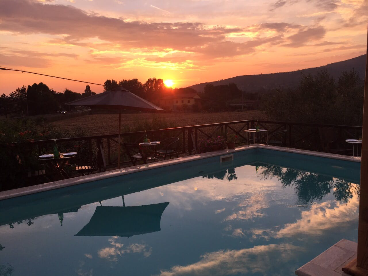 sunset in the swimming pool at il sole del sodo