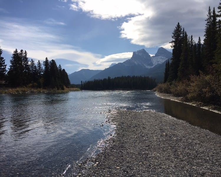 See the iconic Three Sisters Mountain overlooking Canmore, Alberta