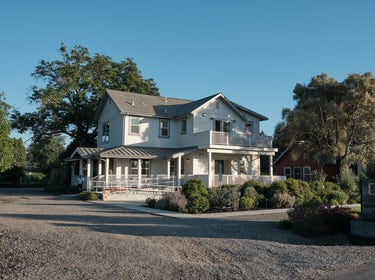 Front entrance of The Setting Inn, recently renovated historic farmhouse near Yountville, CA 1