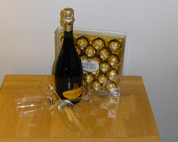 treat yourself to bubbly and chocolates on arrival