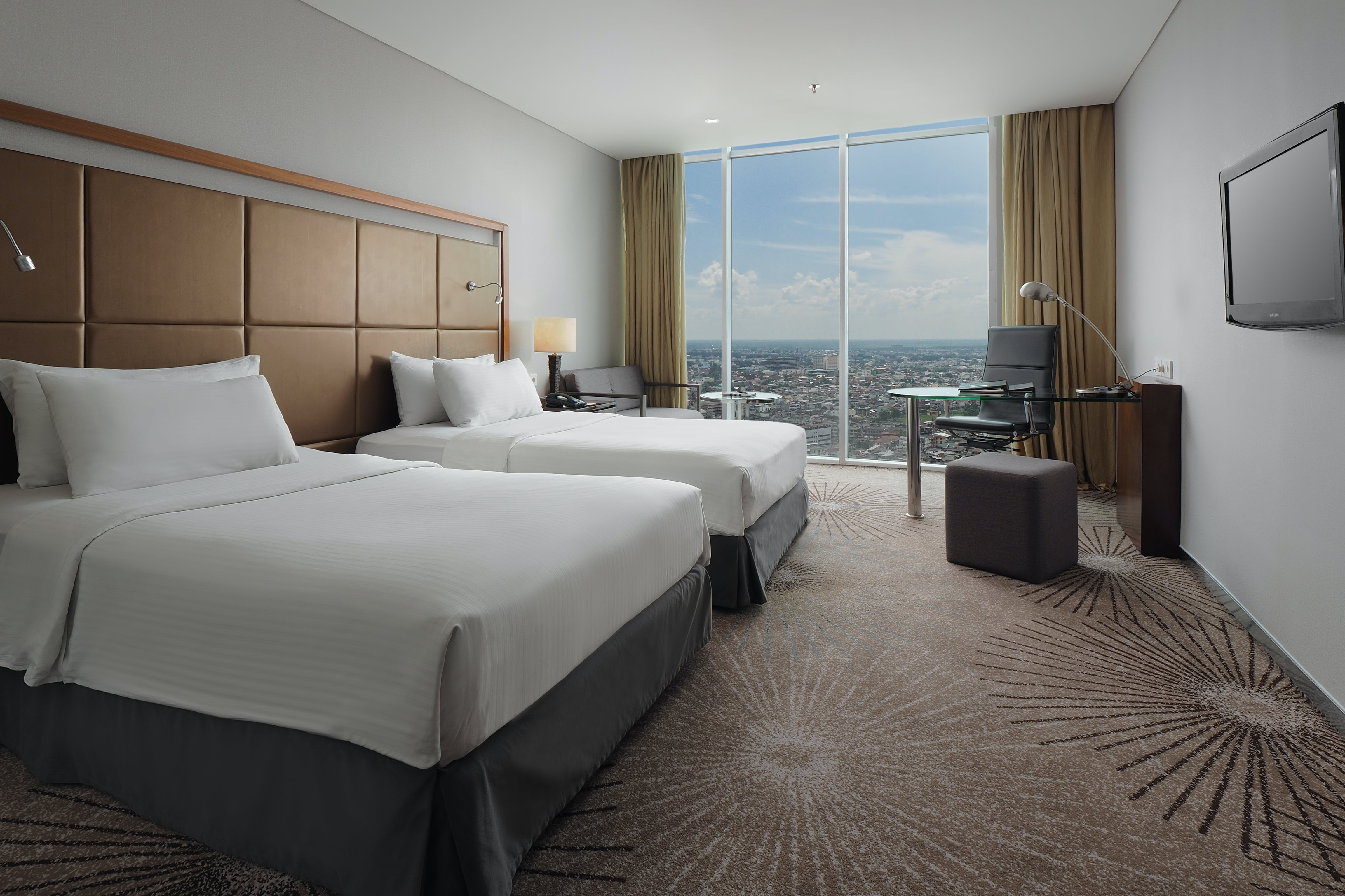 A Superior Deluxe Double bed room with Medan city view