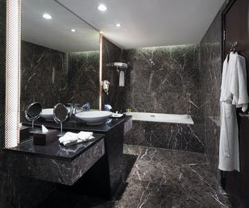 Junior Suite bathroom decorative design with separated shower and bathtub area