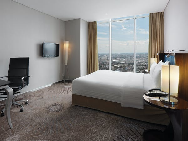 Deluxe Room queen bed room with city view