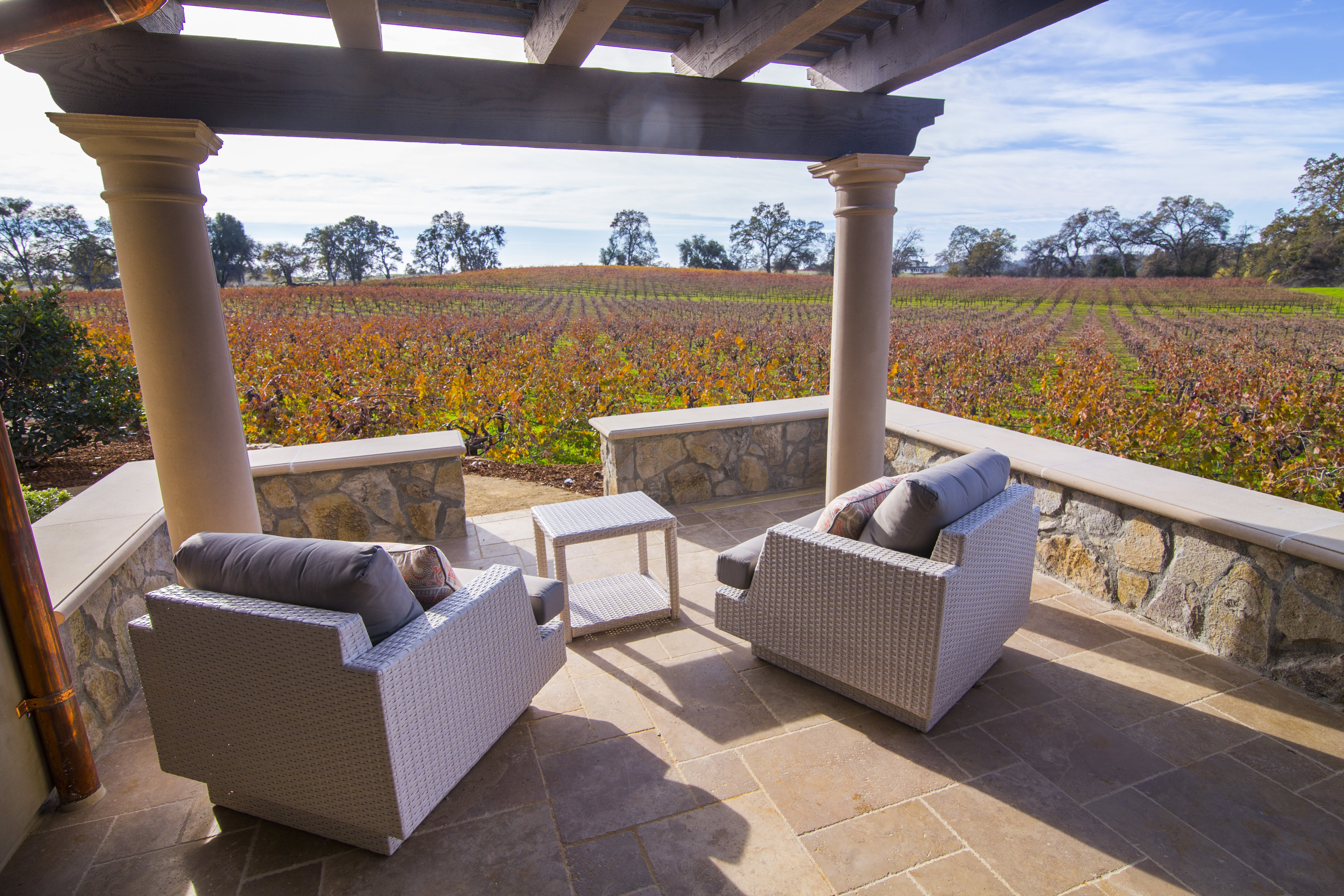 Imagine having your coffee in the morning and your wine in the evening on this private patio with stunning vineyard views