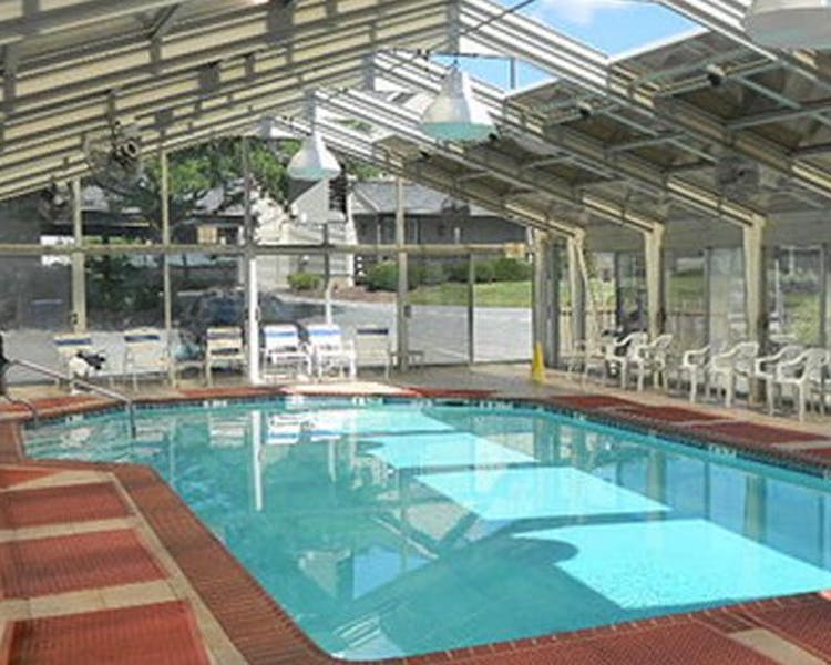 We feature a large indoor outdoor heated solarium pool that is open to swimmers 365 days a year.