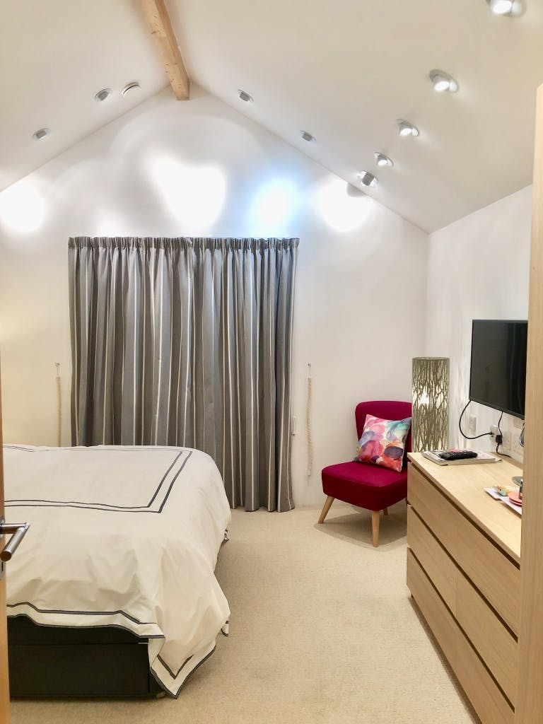 Bedroom 2 with view of vaulted ceiling and down lights