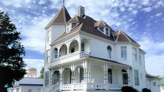 The Victorian on Main bed & breakfast, Fairfield, Il. White, 3-story Queen Anne Victorian architecture.