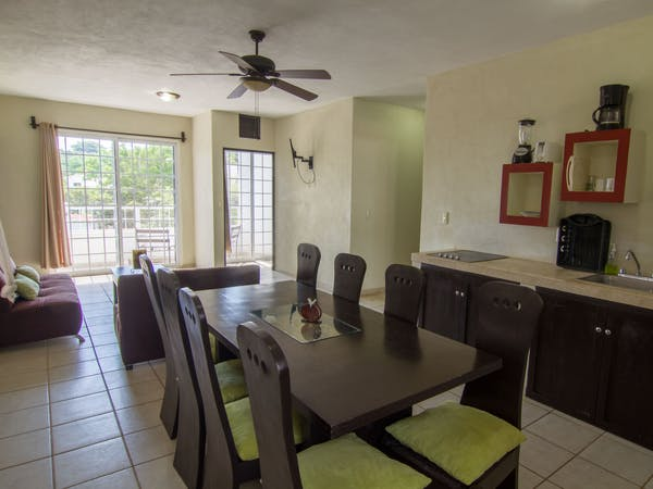 Two Bedroom villa with large open concept living, dining and kitchen areas.