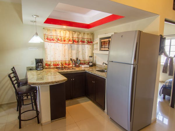 Kitchen with everything you need to prepare a meal or enjoy something from a nearby restaurant!
