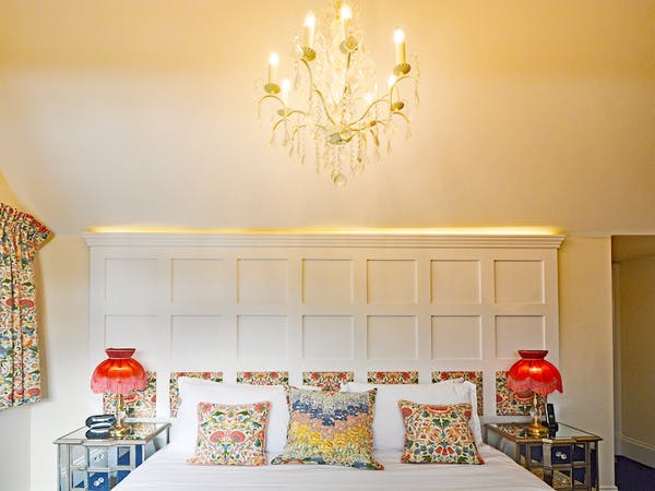 Haven Hall Hotel Bedroom 6 chandelier & bed pillows