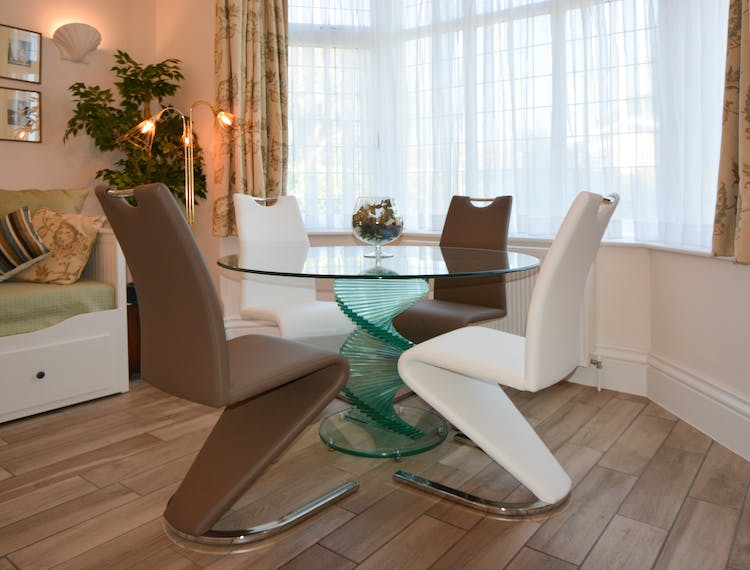 Haven Hall Hotel Garden Suite 1 glass dining table & mermaid chairs