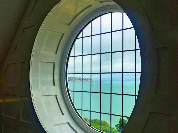 Haven Hall Hotel Penthouse View of Culver Cliff through Round Window