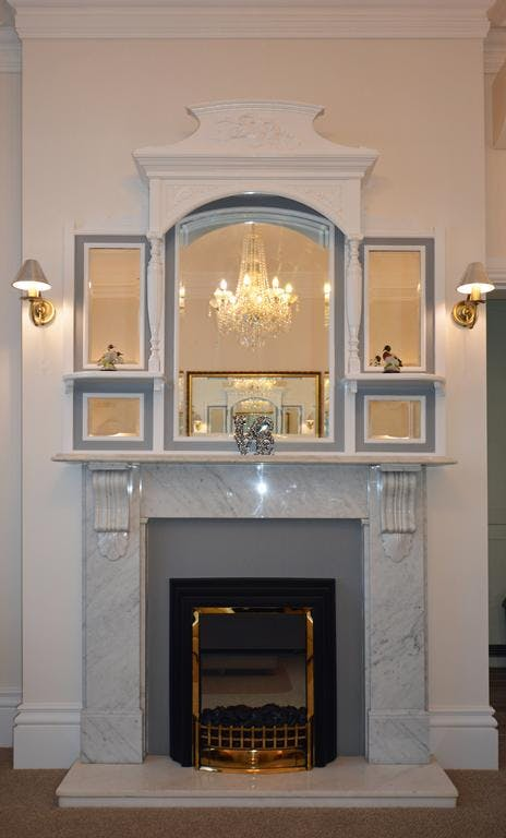Haven Hall Hotel . Gypsophila Suite living room fireplace