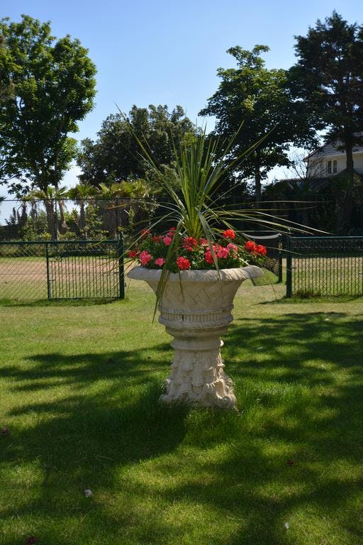 Haven Hall Hotel. View of urn with Tennis Court behind