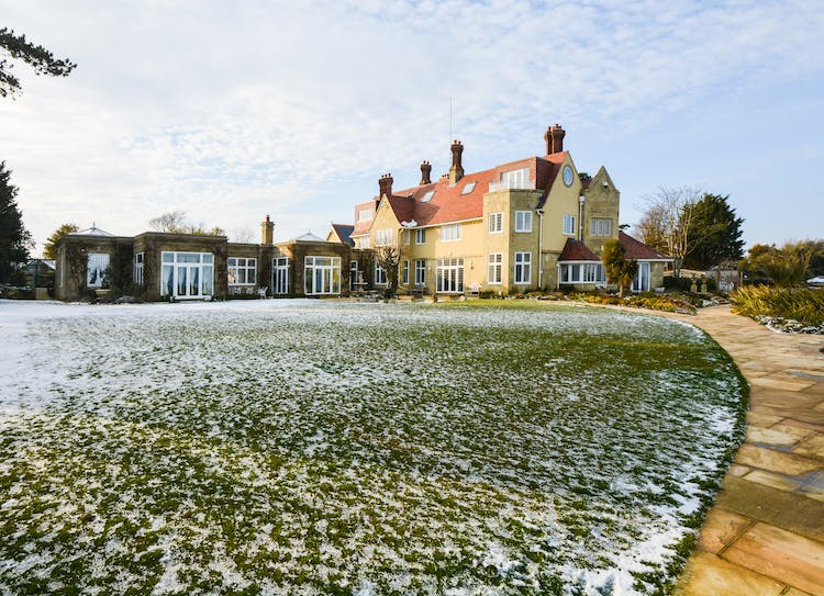 Haven Hall Hotel snowy upper lawn & House