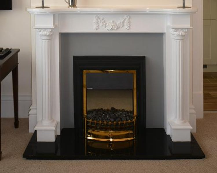 Haven Hall Hotel. Geranium Suite living room fireplace