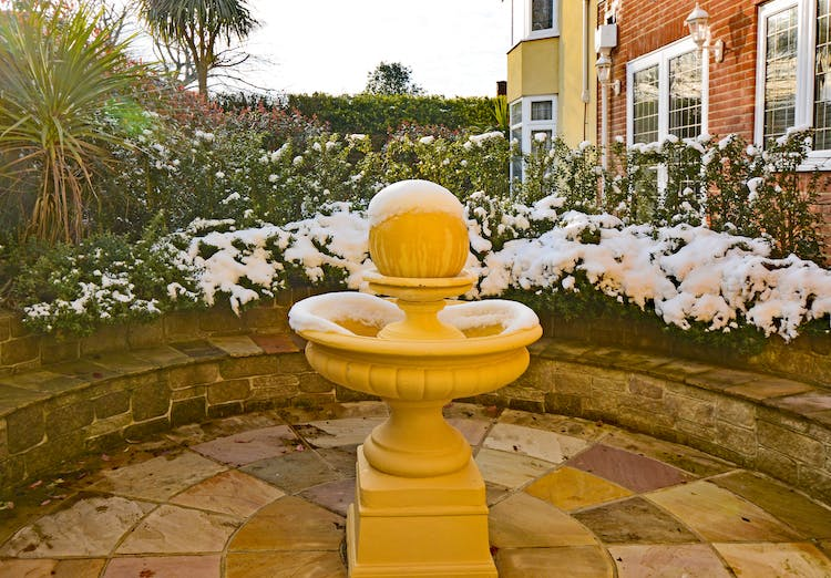 Haven Hall Hotel back patio & fountain with snow