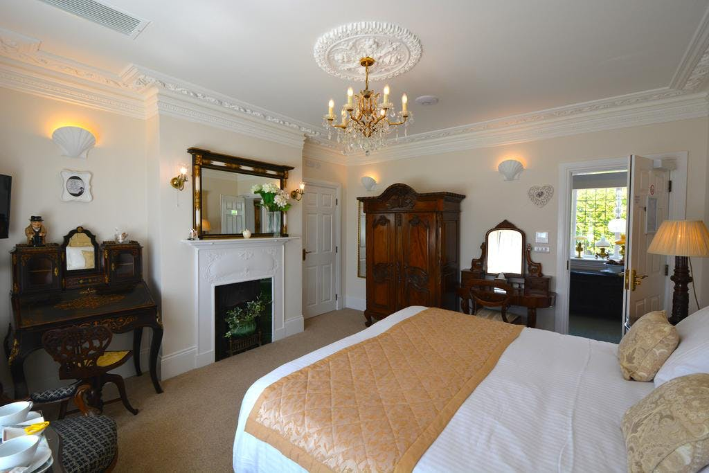 Haven Hall Hotel. Winston Churchill bedroom with fireplace