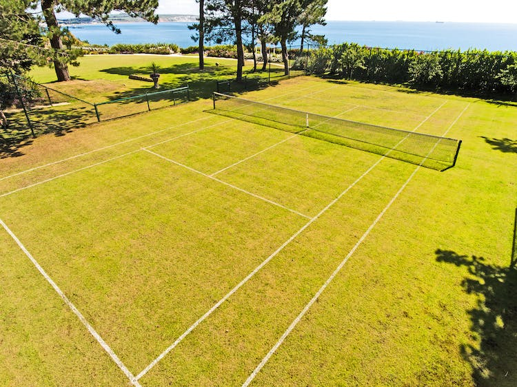 Haven Hall Hotel grass tennis court by the sea