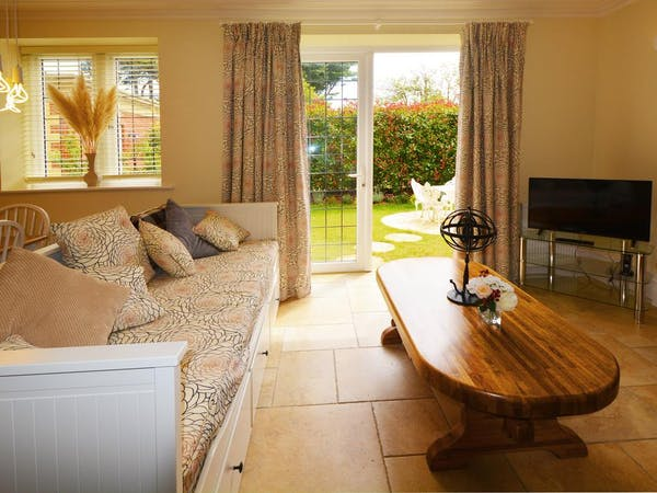 Haven Hall Hotel. Gardenia Suite with view of private patio and garden