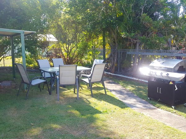 Outdoor BBQ area  with sun umbrella when needed.
