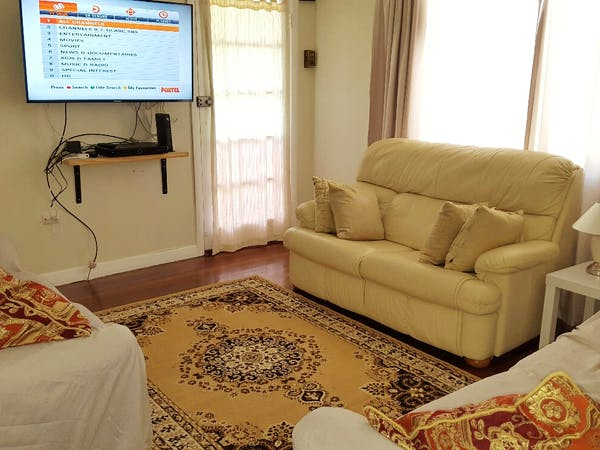 Lounge with foxtel and 3 couches to spread out on.