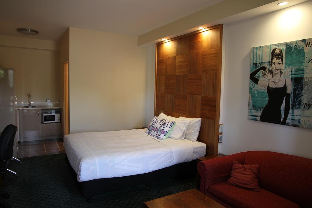 Executive Queen rooms are modern and welcoming.