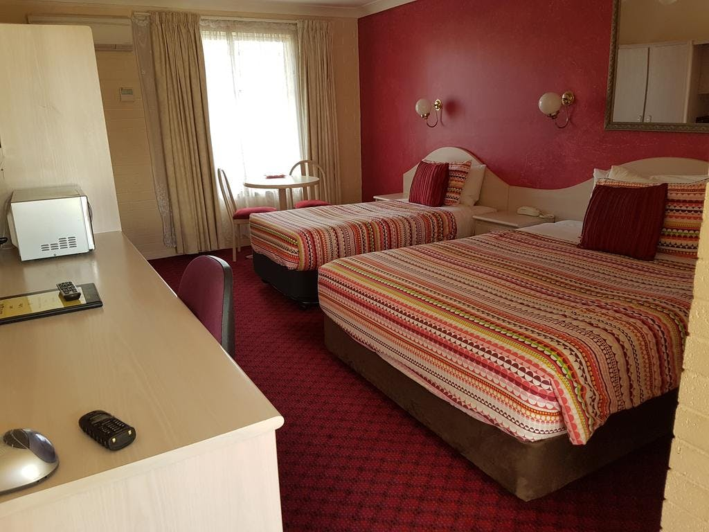 Standard Queen Double (1 bed) and Standard Twin rooms (Queen and single) are roomy and welcoming with modern bathrooms.