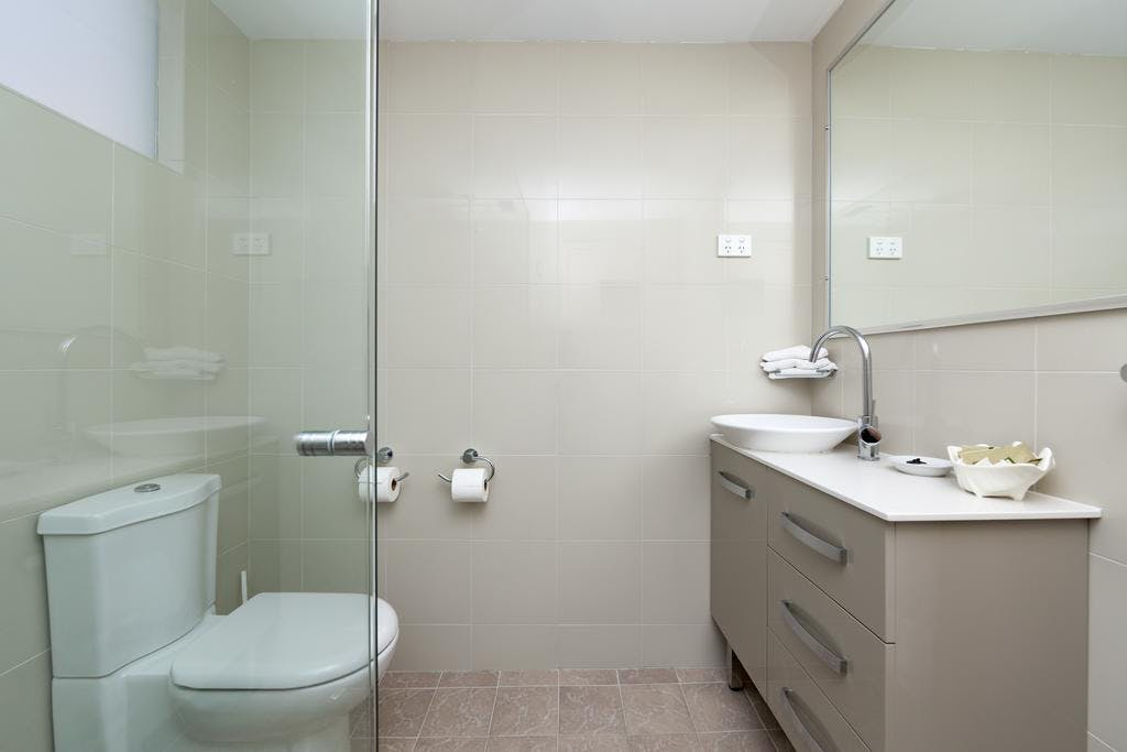 Executive and Standard Queen Bathrooms. Modern Luxury.