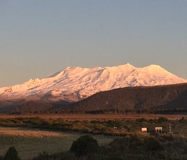 Mt Ruapehu at sunset covered in snow in winter.