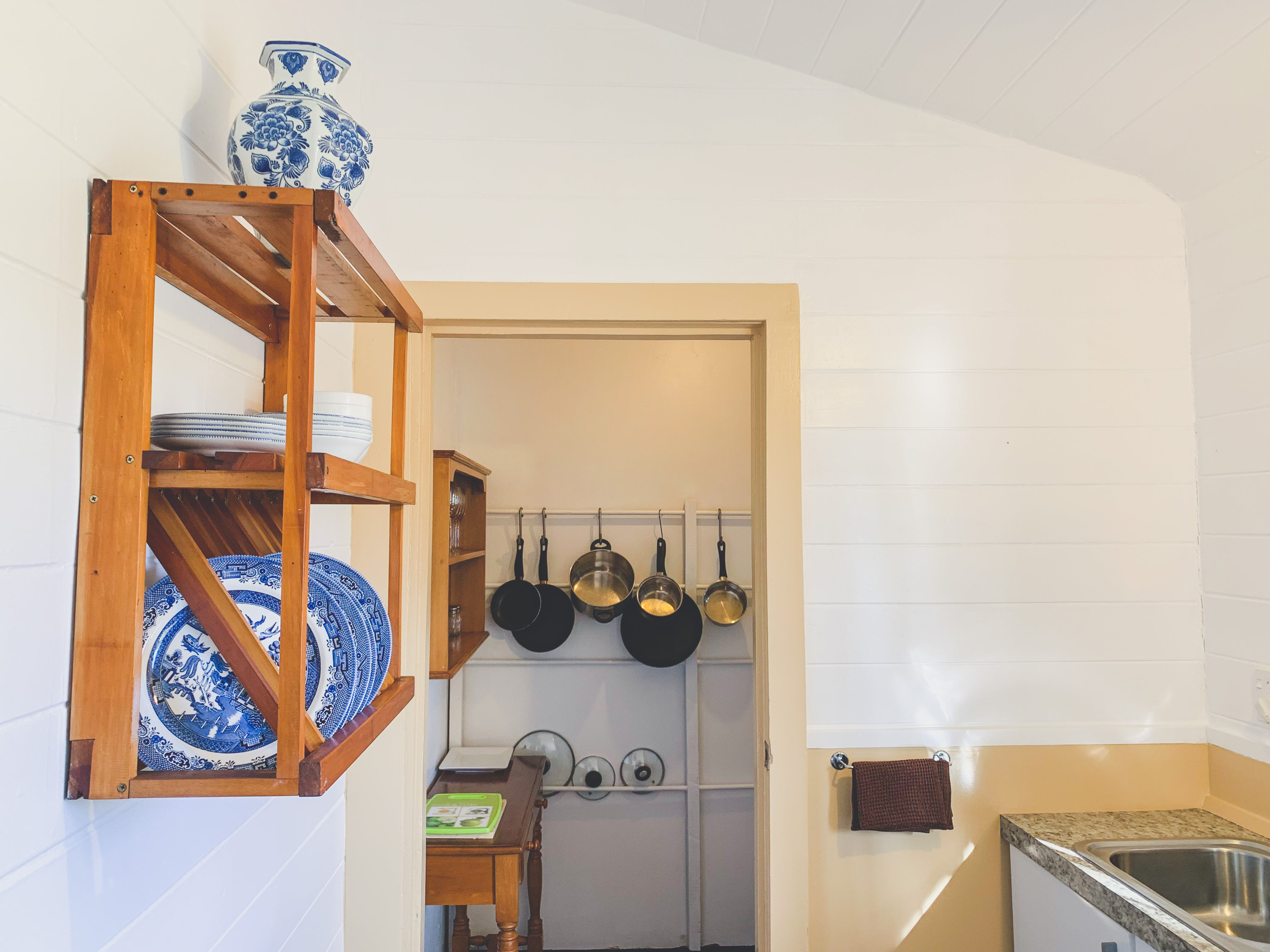 Pipiriki and Jerusalem suite kitchen equipped with cookware and crockery