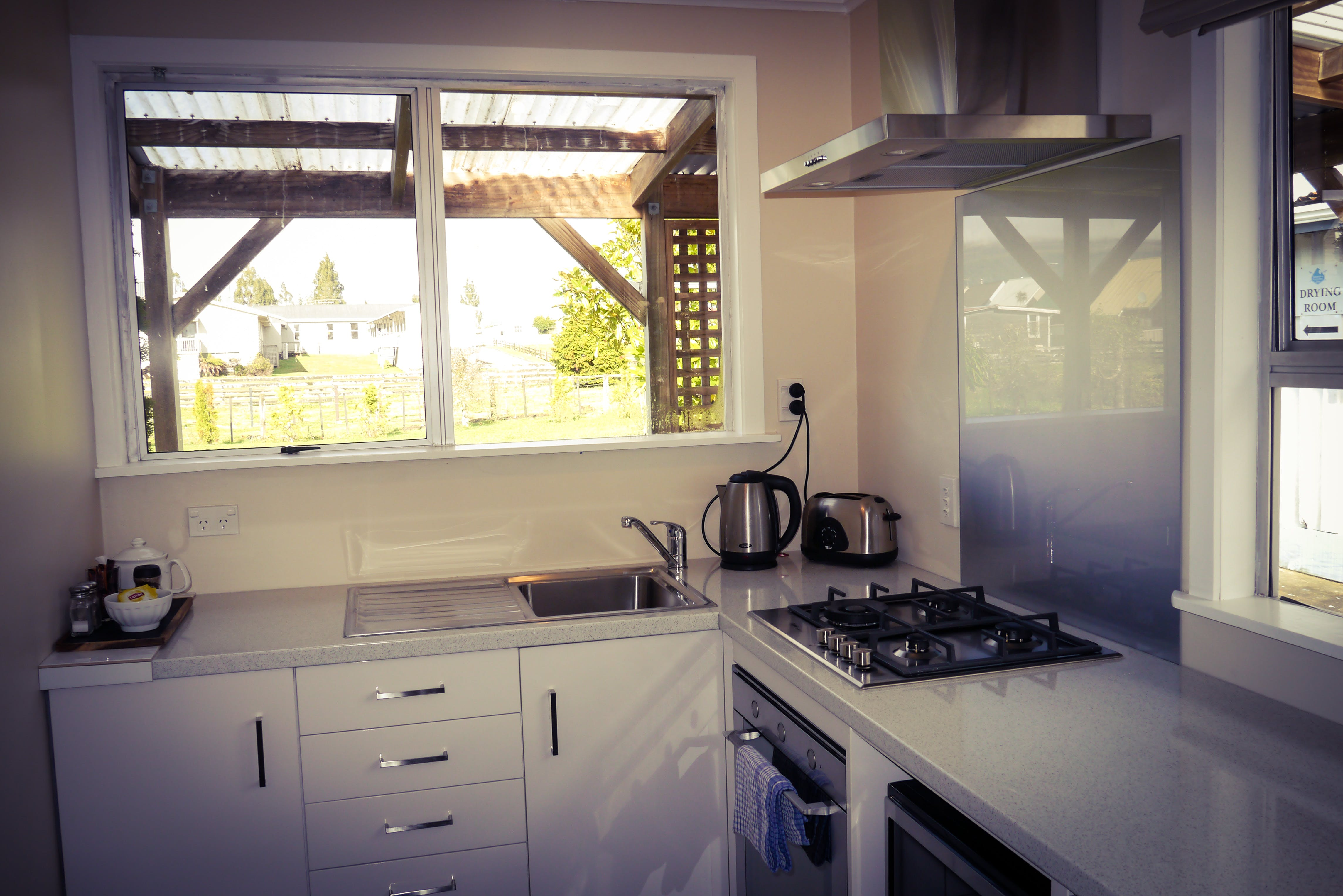 Horopito suite kitchen with kettle, toaster, gas hob and oven