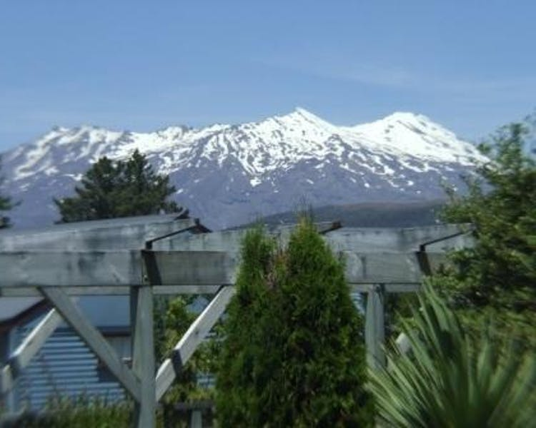 Mt Ruapehu with snow peaks view from the lodge terrace at Tongariro Crossing Lodge