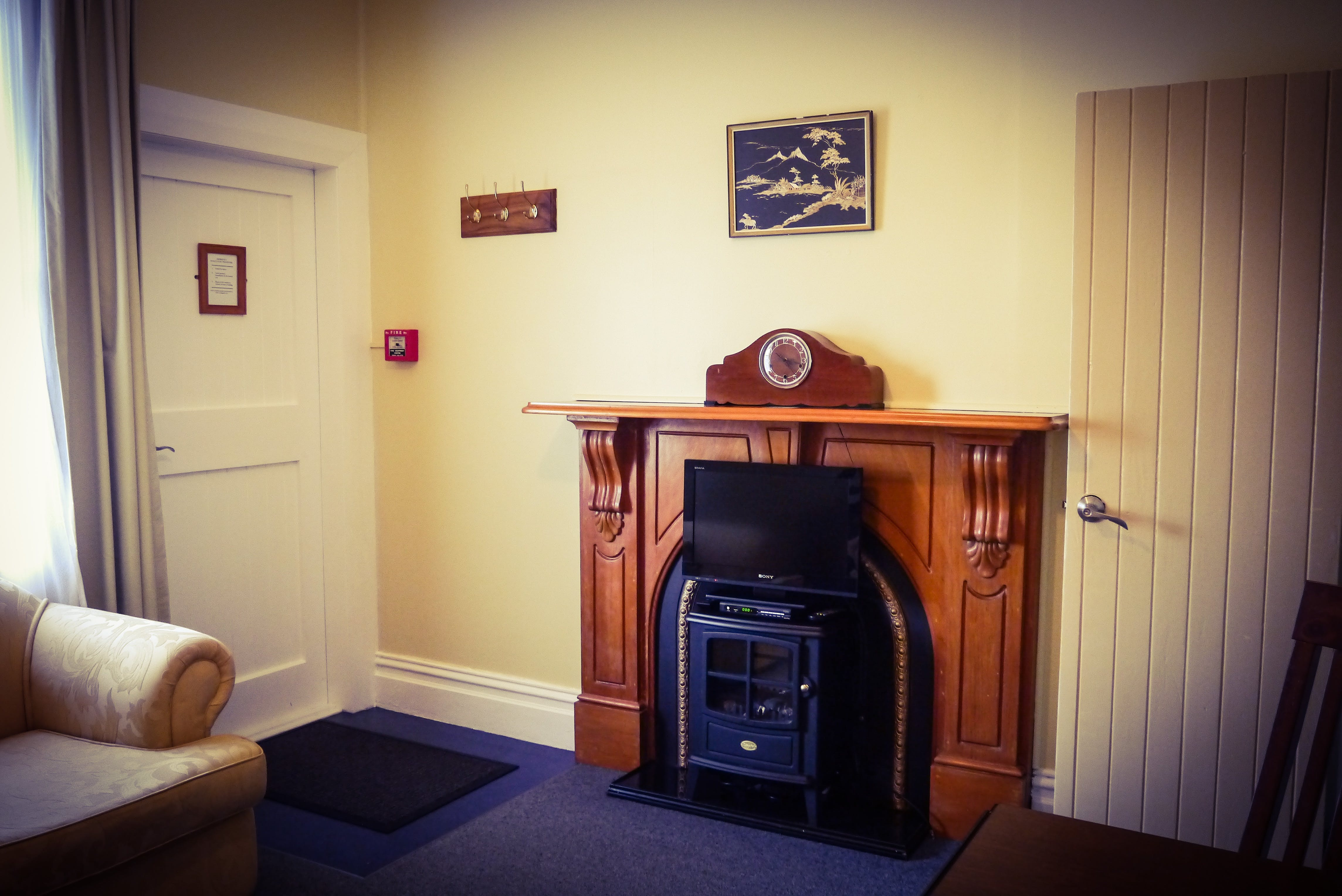 Turoa suite lounge with old style mantelpiece