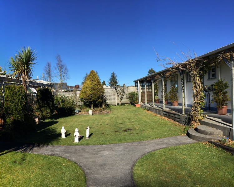 Sunny day on guest terrace with native plants at Tongariro Crossing Lodge