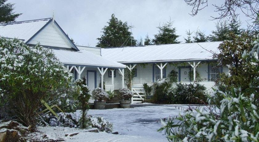 Snow outside Tongariro Crossing Lodge front entrance