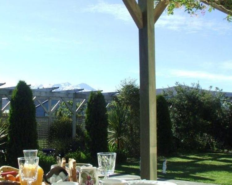 Continental breakfast set up outside in the garden terrace with view of Mt Ruapehu