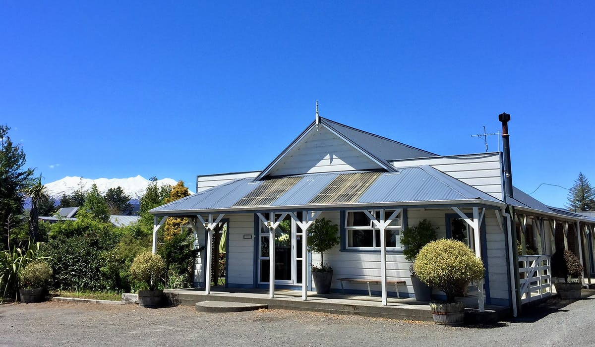 Tongariro Crossing Lodge front entrance with view of Mt Ruapehu in the background