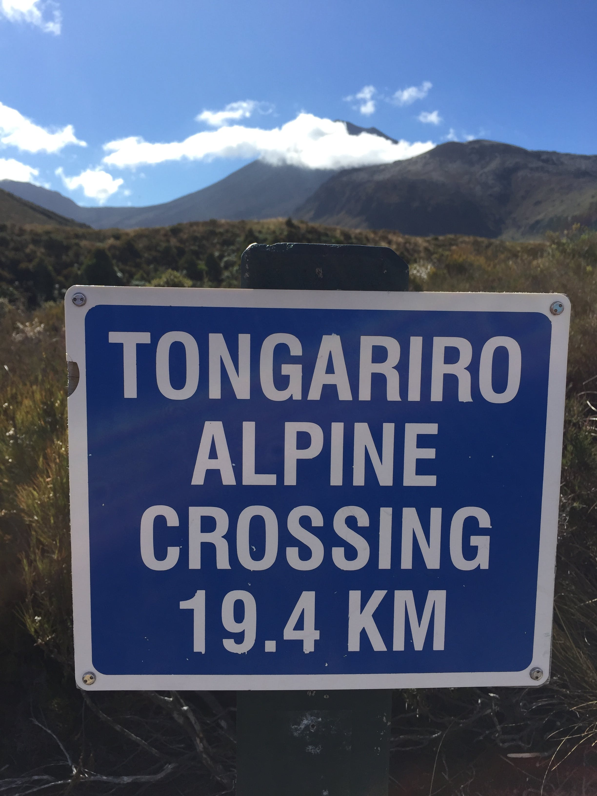 Start of the Tongariro Alpine Crossing sign with 19.4km to go.