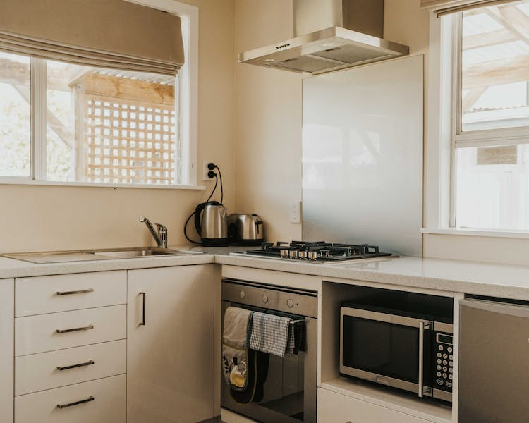 Fully equipped kitchen with microwave, gas hob and oven