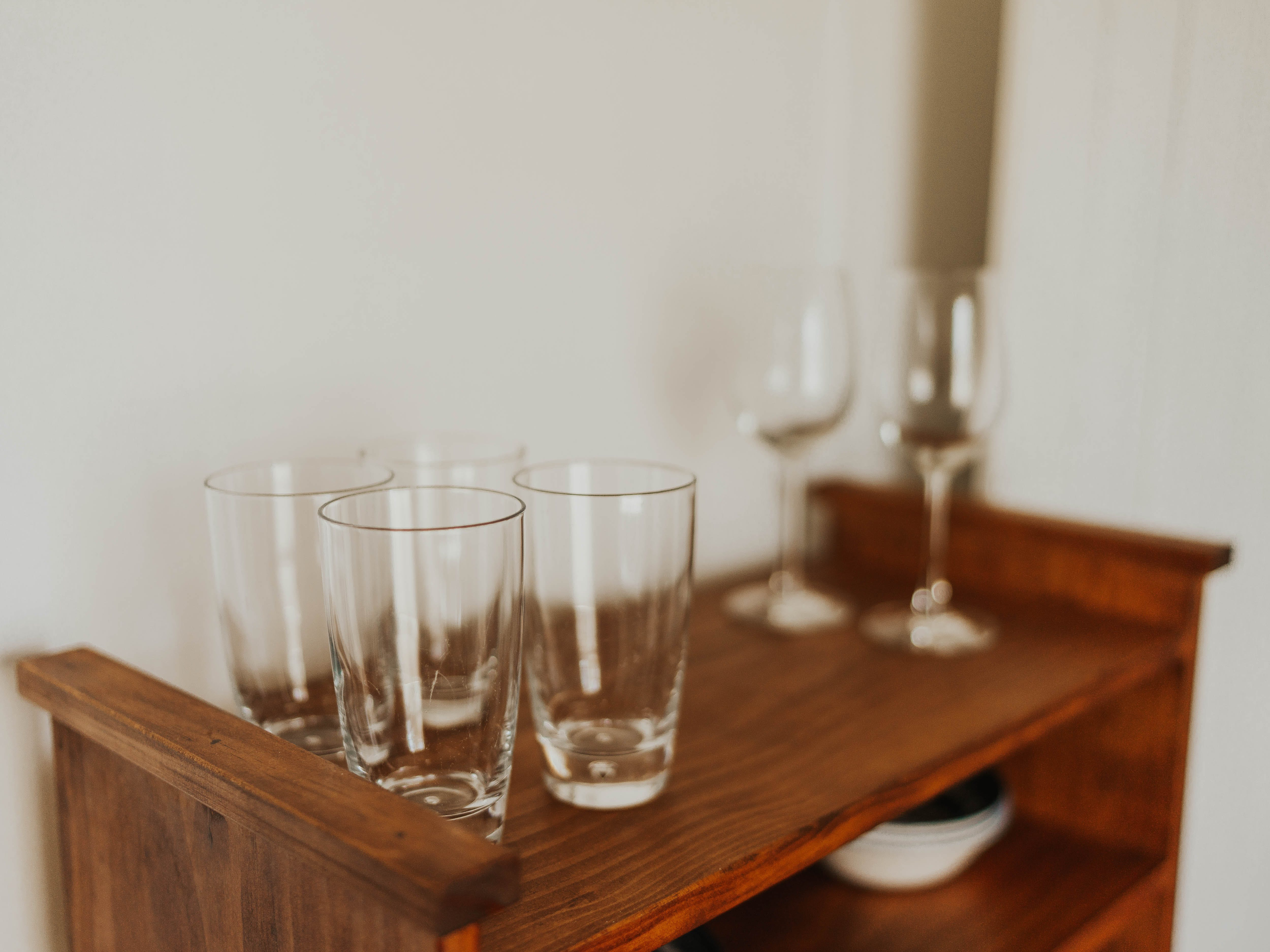 Water and wine glasses in fully equipped Turoa suite kitchen