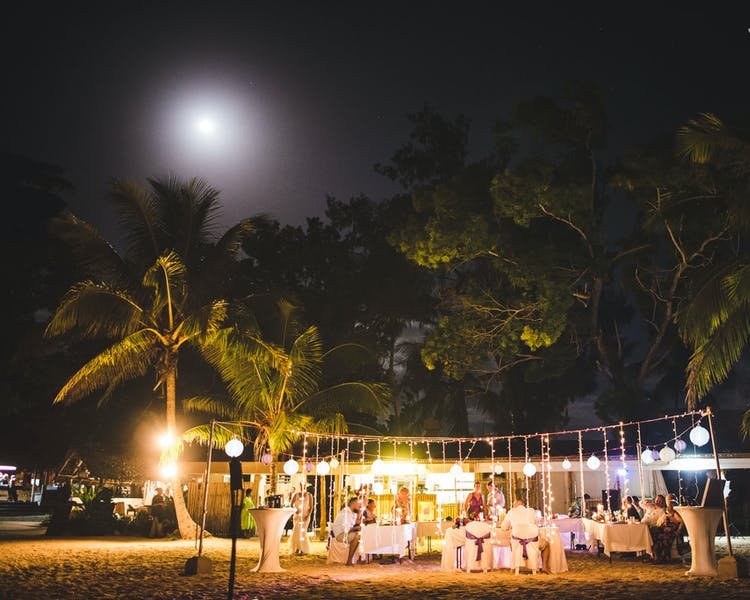 Beach wedding reception with fairylight #erakorbeachweddings #weddingreceptionthebeachsouthpacific
