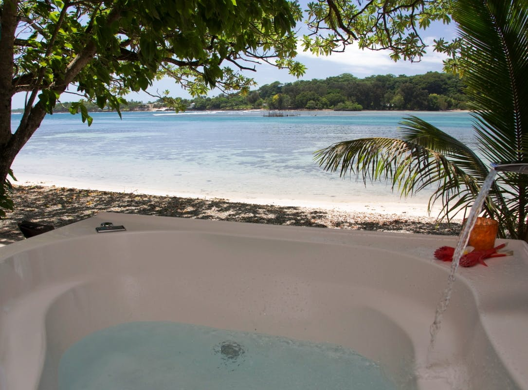 Beachfront Deluxe Spa Villa - 2 person Spa on the deck where you can relax and enjoy the amazing views erakor island
